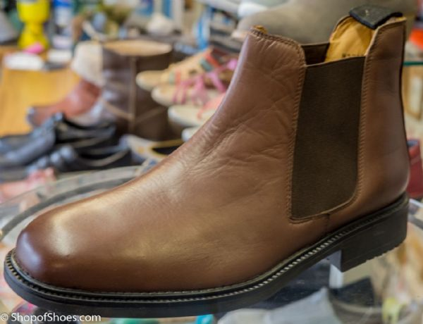 Brown Leather chelsea boot with flexible rubber sole.